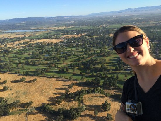 Up & Away Ballooning: My girlfriend over looking a golf course.