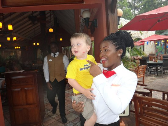 Beaches Negril Resort & Spa: Vanessia in front of Arizona's with our son