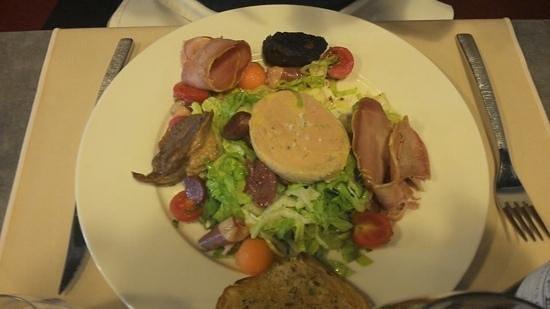 Restaurant La Quincaillerie : duck confit, black pudding, guissards and foie gras with salad and melon, starter.