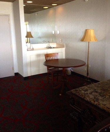 The Claridge - a Radisson Hotel : Sink area which includes a mini fridge