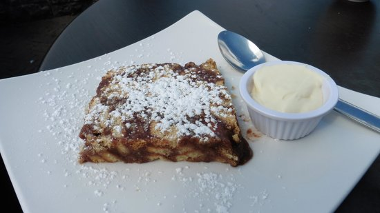 The Good Room: Wonderful cake served warm with chocolate drizzled inside, and powdered sugar sprinkled on top w