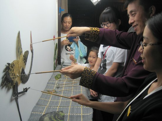 Shichahai Shadow Art Performance Hotel: After the show they invite you to try as well