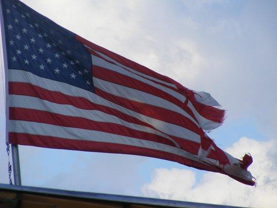 Esperanza Mansion: A battered American flag