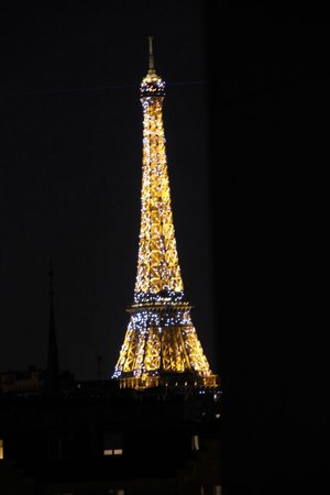HotelHome Paris 16 : Zoomed in Eiffel Tower view from 2 bedroom apartment