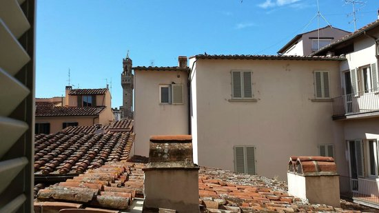 De Lanzi: View over medieval roof tops of Florence.  The tower in the distance is the Palazzo Vecchio