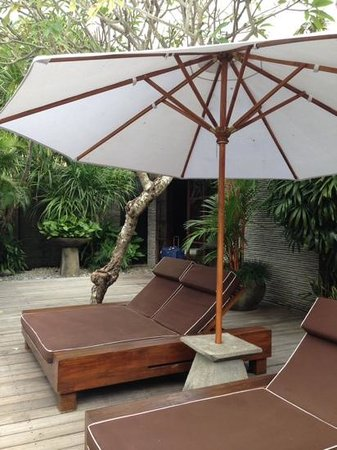 Peppers Seminyak: sunlounges in our villa