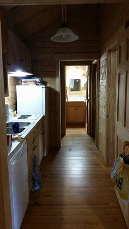 Carowinds Camp Wilderness Resort : View from the living area down the galley kitchen toward the bathroom.