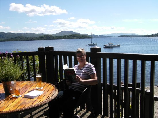 Lodge on Loch Lomond: me reading just after lunch.