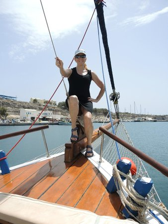 Captain George Santorini Yachting: photo op on the front of the sailboat