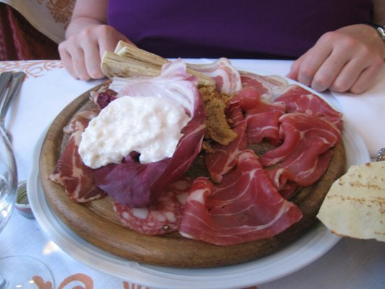 La Gardela: Emilia-Romagna appetizer platter with sliced meats, cream cheese, and piadina
