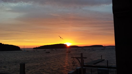 Harborside Hotel & Marina: The gorgeous sunrise and view of the harbor from the deck of 1076 on our last morning.