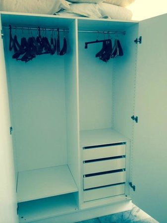 Astir of Paros : Tired Formica Wardrobes with Mismatched Hangers