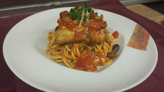 Briscola Restaurant: Baked Halibut a top a bed of house made spaghetti with a puttanesca sauce.