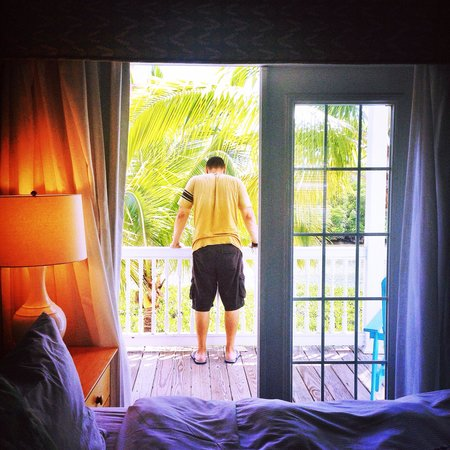 Parrot Key Hotel and Resort: Hubby taking in water view beauty from porch
