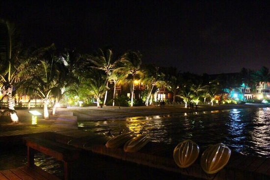 Pineapple Restaurant: Ramon's Village at night lights up San Pedro's beach with energy and life.