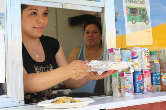 San Juan Taqueria: Joanna serving delicious food to a customer who told me he loves the place and comes there often