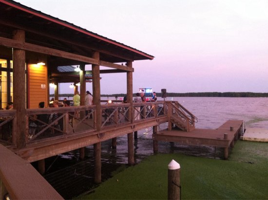 The Regatta Seafood and Steakhouse: Sunset on the back side deck, nice!