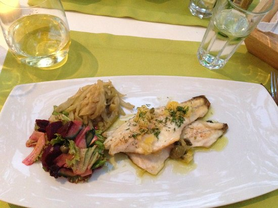 Levantis: Grilled fillet of sea bass with a fantastic preserved lemon and caper dressing!