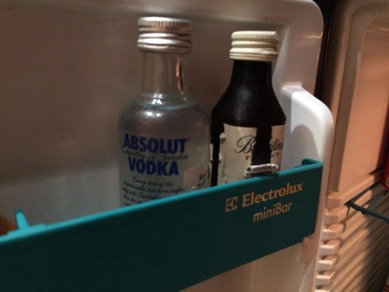 The Oberoi Grand: torn bottles labels in minibar