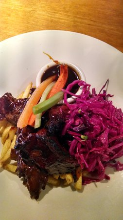 Truffle Pigs Bistro & Lounge: Button ribs with pickled cabbage salad.