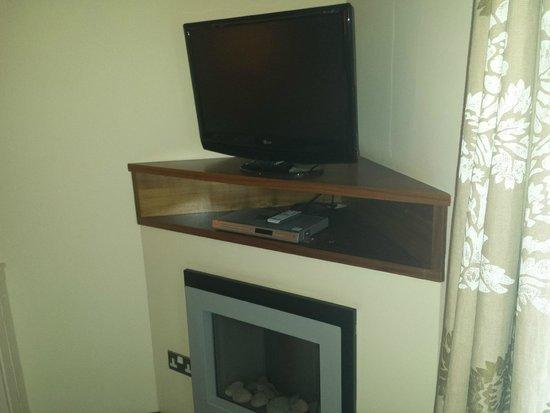 Big Blue Hotel: TV, above fire
