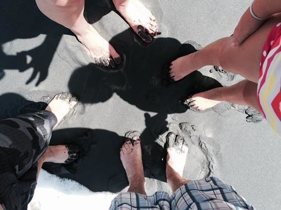Black Sand Beach: toes in the sand