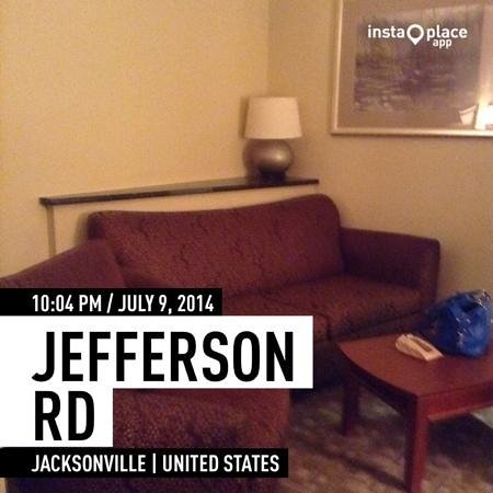 Holiday Inn Express Jacksonville East: room picture of living room  section of the room
