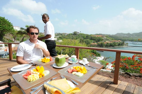 The Cave House at Mount Hartman Bay Estate: breakfast on the terrace - phone to book