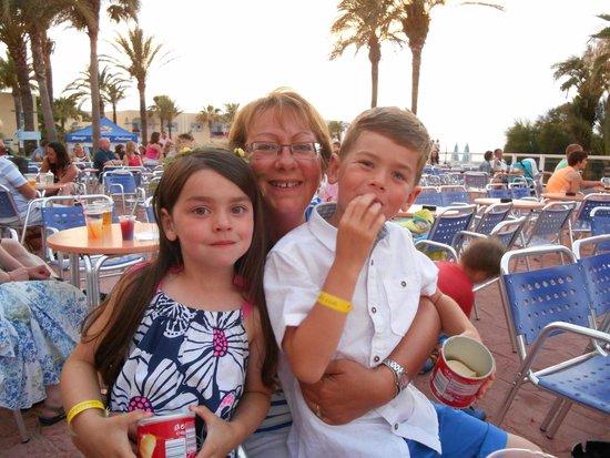 TUI Family Life Sirenis Aura : Poolside near the bar and entertainment area.