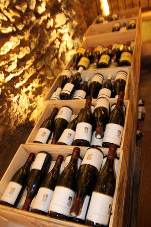 Les Caves Saint Charles: Boxes of wine line the tasting area