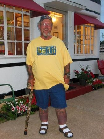"""Boots Court Motel: Ron """"Tattoo 66 Man"""" Jones in front of Boot's office"""
