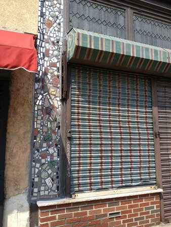Philadelphia's Magic Gardens: Isaiah Zagar art work on 2 small walls.