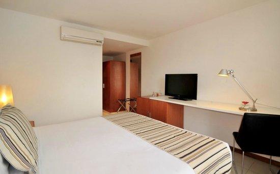 Real Colonia Hotel & Suites : Habitación Deluxe