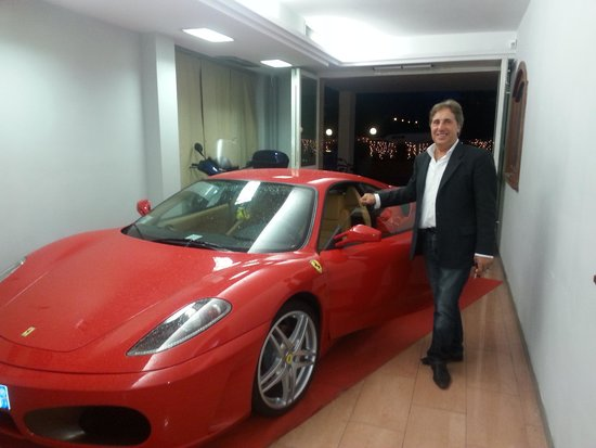 Hotel Savoy Palace - TonelliHotels: The owner with his Ferrari.