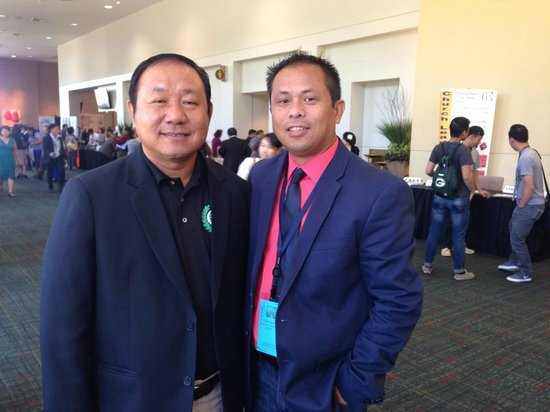 Sheraton Overland Park Hotel at the Convention Center : Me in the red salmon shirt with a Pastor from Thailand