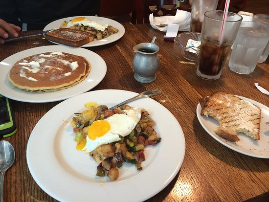 Rise N Dine Pancake Cafe: Veggie skillet, split in half, with side or toast and pancakes.