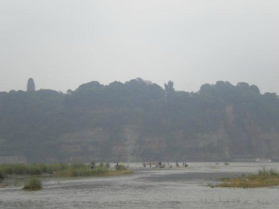 Leshan River, Friend and Foe: View across the river toward the Buddha