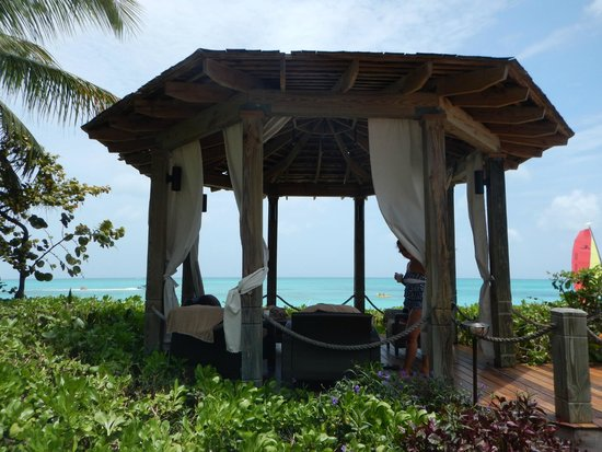 Beaches Turks & Caicos Resort Villages & Spa: Our daily hideout. Beautiful little hut right by the beach.