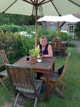 Tudor Farmhouse Hotel: enjoying a drink in the garden