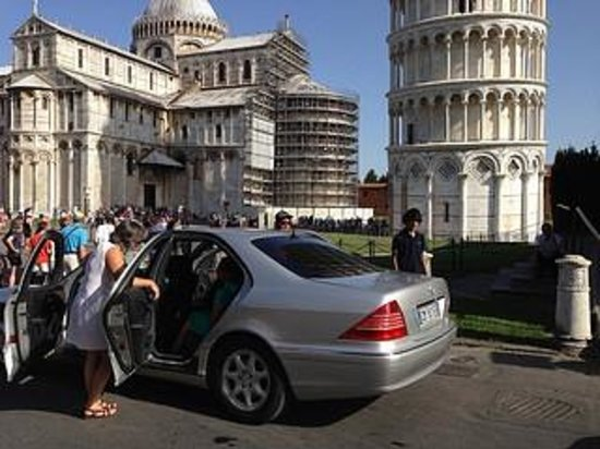 Rome in Limo Tours & Excursions: Near Leaning Tower of Pisa ! The lady in white-driver/guide. Son appreciated this as he was unwe