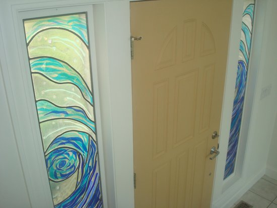 Sun and Surf Bed and Breakfast: Stained glass at front door