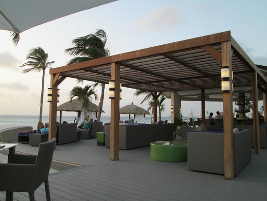 Elements Restaurant - Adults Only: The bar area of the Bucuti & Tara Resort is adjacent...