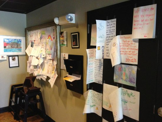 One Dish Cuisine Cafe, Deli & Bakery: Maureen and Dave love it when kids draw and hang their creations up on the wall!