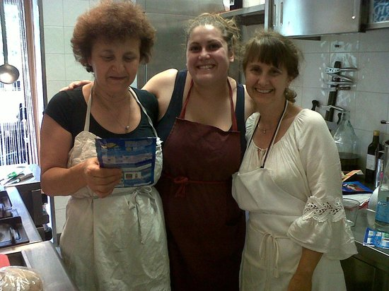 Cooking Vacations Italy : In the kitchen with Simonetta and Sara and me in white.