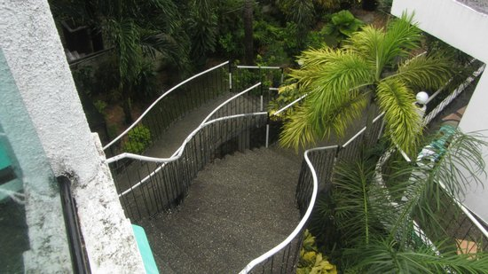 Turtle Inn Resort: The staircase leading up to the room and down to the lobby