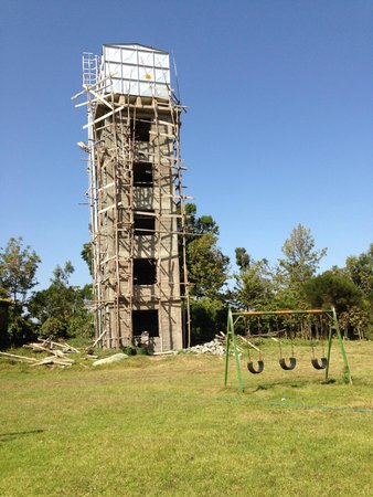 Mt. Kenya Leisure Lodge: Playground area with under-construction water tower and rubble around it