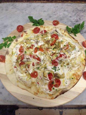 Pizza speciale al ristorante Oltremare
