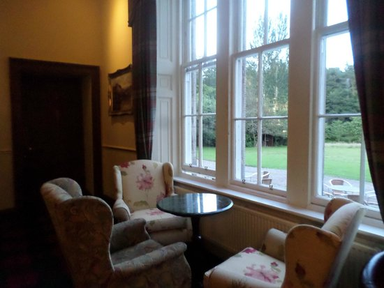 Melville Castle: lounge with view to grounds