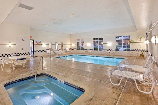 Holiday Inn Express Pendleton : Relax on chairs and enjoy our indoor Swimming Pool
