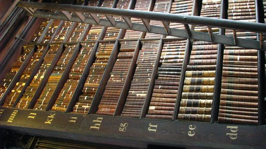 The Book of Kells and the Old Library Exhibition: Library shelves full of historic books